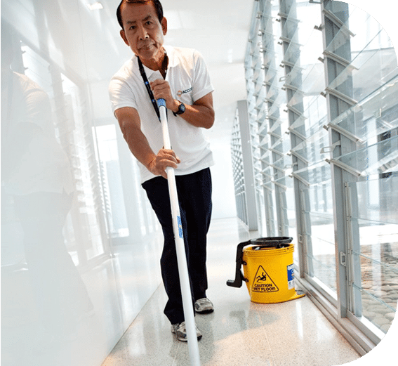 a cleaner mopping the hallways of a strata